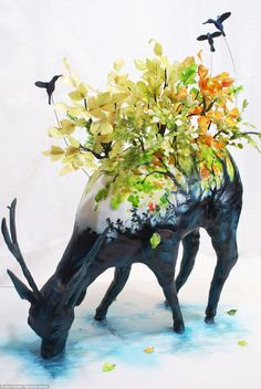 Watering a Life into Itself won fifth place in the 3D category. It shows a deer drinking from a lake with trees made made out of edible wafer paper, leaves dyed with food colouring and branches made out of baker's gum paste