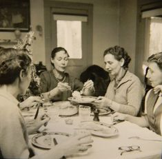 Caroline Ferriday sharing a meal with surviving Polish Lappins from Ravensbruck.