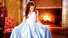 a young, innocent Regina in a baby blue gown with a gorgeous bodice and limply unadorned skirt.