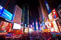 Known to many as the Crossroads of the World, Times Square is the geographic heart of New York's theater district. It is one of the most popular tourist attractions in the world, especially on New Year's Eve when a glittery ball falls at the stroke of midnight.