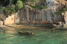 Sunken City - where the underwater ruins, columns and sarcophagi of an ancient shore side city lie clearly strewn in the sea bed shallows consists of island of Kekova, the villages of Kaleköy and Üçağız and the four ancient towns of Simena, Aperlae, Dolchiste and Teimioussa. Turkey