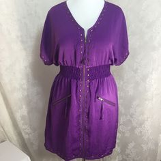 Stylish Purple Dress with pockets! Stylish Purple Dress  100% Polyester This dress it's amazing! I believe you will like it. It has elastic waistband. Copper color zipper and studs are amazing. Size 0? I think is the brand? I'm not very familiar but I have the whole run 0,1,2,3 and 4. For me this one is an XL or 0X Z. Cavaricci Dresses
