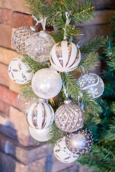 Christmas Decorating Ideas for a Rustic Glam Mantel: Silver and White Christmas Ornaments on Potted Tree