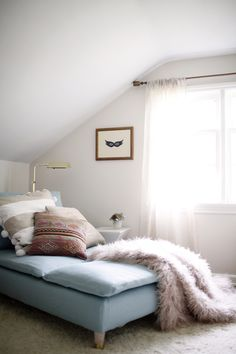 soft pinks and blues mix with gold and plenty of furry textures in this relaxed dressing room nook // coco+kelley
