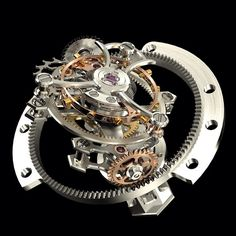 The Tri-Axial Tourbillon by Girard-Perregaux features a regulator on three separate axes. At its heart beats a traditional tourbillon. Its cage performs one rotation in one minute. It is integrated within a structure positioned on a second axis and performs a complete rotation in 30 seconds. Finally, both are inserted into a third system. The ensemble is placed on a third axis and performs one rotation in 2 minutes. The diameter of the ensemble comes to 13.78 mm.