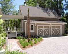 Barn style garage and a breezeway porch.