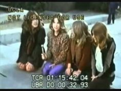 Manson Family Girls singing on the corner during the trial