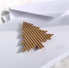 These simple but elegant trendy Christmas cards have a corrugated kraft paper hand punched raised tree attached to each. Each card has squared corners to keep a simple look. These cards come in a set
