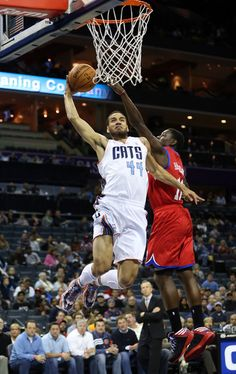 Jeffery Taylor #44 of the Charlotte Bobcats drives to the basket against Jrue Holiday #11 of the Philadelphia 76ers during their game at Time Warner Cable Arena on November 30, 2012 in Charlotte, North Carolina.