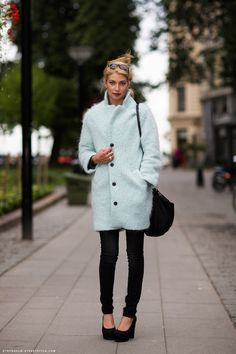 Cecilia Forss in a mint coat combined with the all black look.