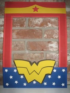 Wonder  Woman Superhero Cardboard Frame.....Cardboard painted with red and royal acrylic paint.  Colored card stock used to trim the frame edges, cut out stars, emblem and headband.