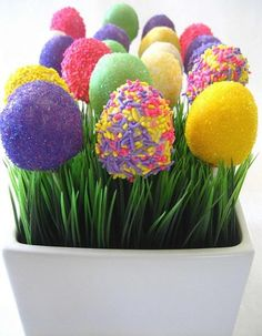 Okay...pinned as Easrer cake pops, but i see a vase arrangement. Artificial chives with plastic easter eggs painted or covered with glitter!