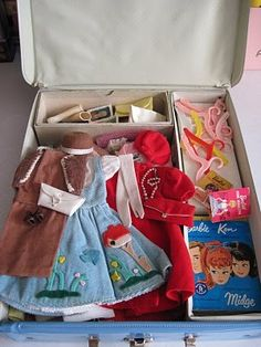 Vintage Barbie Case and Clothes Recognize that dress anywhere and those plastic hangers. ( Joan would not have approved)! Lol