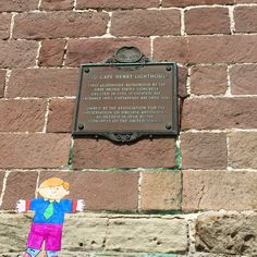 Old Cape Henry light house sign about Congress authorizing funds. Flat Stanley.
