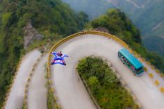 Wing Suit Base Jumping...hopinefully along the beautiful China country side or equivelent