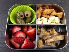 School lunch of grilled chicken, cheese, rice crackers, olives, and strawberries (all gluten-free) in the LunchBots Quad