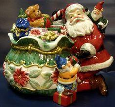 Santa with elves cookie jar