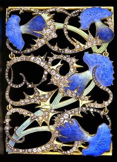 René Lalique. A collar plaque made of gold, enamel and diamonds with four striking blue flowers