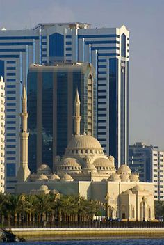 Sharjah Mosque and skyscrapers in Dubai, UAE Sharjah, Islamic Architecture, Art And Architecture, Abu Dhabi, Asia, Beautiful Mosques, Amazing Buildings, Islamic World, Place Of Worship
