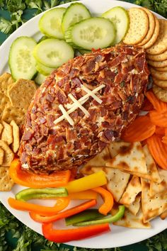 Nothing tops a flavor-packed, bacon-covered cheese ball while watching sports of all kinds. But this cheese ball recipe is the clear winner as a football-themed appetizer idea thanks to its distinctive shape. #superbowlrecipes #appetizers #tailgaterecipes #fingerfoods #apps #bhg Vegetarian Grilling, Healthy Grilling Recipes, Barbecue Recipes, Barbecue Sauce, Holiday Cheese Ball Recipe, Cheese Ball Recipes, Game Day Snacks, Game Day Food, Bhg Recipes