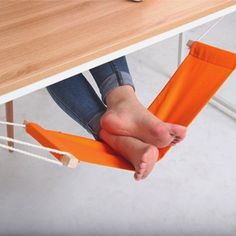 This unique hammock design replaces that extra chair you use to prop your feet up.The foot rest is a desk hammock designed specifically for resting your feet.It hooks onto either side of any desk with two metallic clips.Length of rope is adjustable: 200 mm to 450 mm.Made from cotton, steel, & polyethylene.