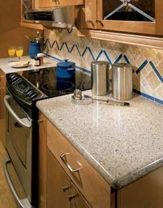 Another view of blue sahara quartz on white cabinets ...
