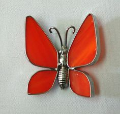 Stained glass butterfly.  Lead came finished in chrome.