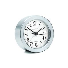 Round alarm clock in nickel.