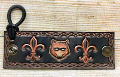 Happy Canada Day! Celebrate it by putting your hair up in this handcrafted leather hair tie featuring an embossed and painted Wolf between two Fleur De Lis! This was actually a custom design request from a customer in Canada and we liked the design so much we've decided to offer it permanently on our Handmade At Amazon shop! Are you doing anything special for Canada Day? . . . . . #CanadaDay #ohcanada #Canadianwolf #FleurDeLis #wolf #wolves #werewolf #hairtie #leatherhairtie #ponytail…