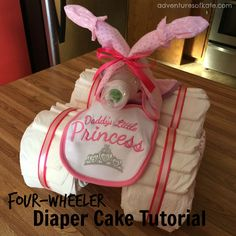 This tutorial shows step by step instructions to make your own four-wheeler diaper cake!  I always have people asking me to make these for a baby shower or a gift!  They are super easy to throw tog…