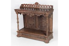 A tall 19th Century carved oak Buffet, with attractive carved and pierced back rail, the carved f