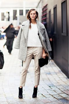 Grey coat, white shirt, beige pants, black ankle boots, and black clutch