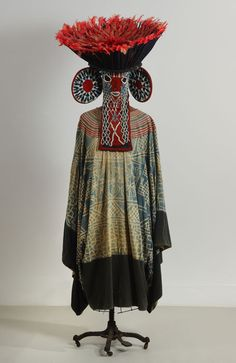 Kuosi Society ensemble (Bamileke, Cameroon) Fabric, beads, parrot feathers, 48 in