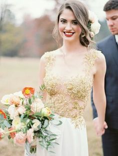 Gold lace dress for the bride - love the touch of the fresh flowers #wedding #gold #goldwedding #bride #dress