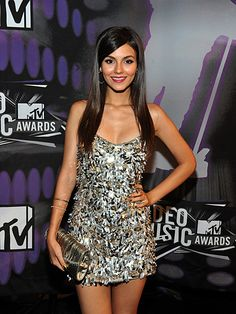 Victoria Justice photographed on the red carpet at the 2011 MTV Video Music Awards in Los Angeles.