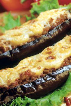 Stuffed Eggplant with sweet Italian sausage, garlic, parsley, white wine, Italian bread crumbs, parmesan, pepper and diced eggplant