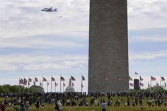 Final flight    People gather at the base of the Washington Monument to watch as the U.S. space shuttle Discovery, attached to the back of a NASA 747 transport jet, flies over the National Mall on its way to its final home at the Smithsonian Institution, in Washington, April 17.  Jonathan Ernst / Reuters