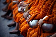Bangkok, Thailand: Buddhist monks attend an alms ceremony   Photograph: Damir Sagolj/Reuters