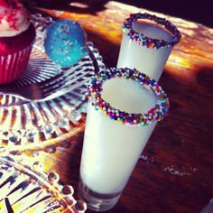 Shot Glasses with Milk and Sprinkles for New Year's Eve