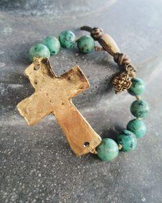 Sideways cross bracelet 'Sacrifice' African turquoise, rustic hammered gold cross, religious via Etsy.