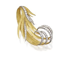 18 KARAT GOLD, PLATINUM AND DIAMOND BROOCH, FRENCH Designed as stylized feathers set with round diamonds weighing approximately 3.80 carats, gross weight approximately 24 dwts., numbered 3095, French obus mark.