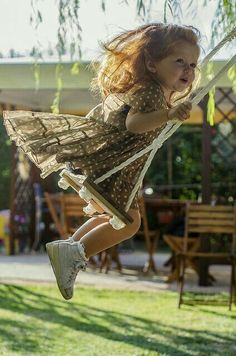 Love this little girl on a tree swing . by David Pellicola