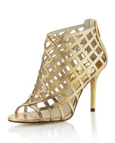 """Back zip. 3 1/2"""" covered heel. Lightly padded insole. Imported. About Michael Kors: Famous for producing polished, sleek, sophisticated Amer..."""