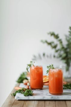 a carrot, ginger, and orange juice fresca drink that's perfect for summer   this brown kitchen