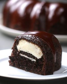 Chocolate Bundt cake Stuffed with Cheesecake. This Bundt Cake Is Stuffed With Cheesecake And Glazed With Chocolate Chocolate Bundt Cake, Chocolate Desserts, Chocolate Cream Cheese Cake, Chocolate Chocolate, Oreo Cake, Food Cakes, Cupcake Cakes, Just Desserts, Delicious Desserts