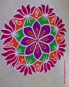 50 Easy Rangoli Design (ideas) that you can make yourself or get it made during any occasion on the living room or courtyard floors. Indian Rangoli Designs, Rangoli Designs Latest, Simple Rangoli Designs Images, Rangoli Designs Flower, Rangoli Border Designs, Rangoli Designs With Dots, Beautiful Rangoli Designs, Rangoli With Dots, Diwali Special Rangoli Design