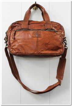 Tan Leather Laptop Bag and Briefcase in beautifully aged vintage style leather can be worn cross-body, over the shoulder or carried by its shorter handles as a briefcase. Sturdy and stylish, with plenty of room for a laptop and paperwork. For a relaxed, laid back look.