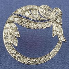 Art Deco Platinum, Sapphire, and Diamond Circle Brooch | Sale Number 2323, Lot Number 674 | Skinner Auctioneers