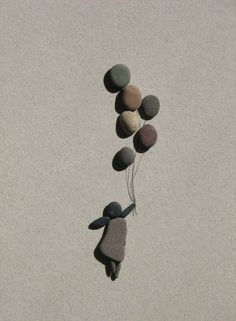 """How cute is this adorable pebble art?  Something fun you can make with the kids while you're outside for a few minutes (seems like I am always waiting for someone, and you can let the kids look around for sticks and rocks - they will get a kick out of making this)."""