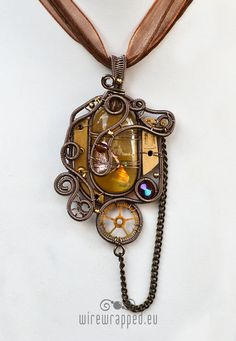 Wire wrapped steampunk pendant.